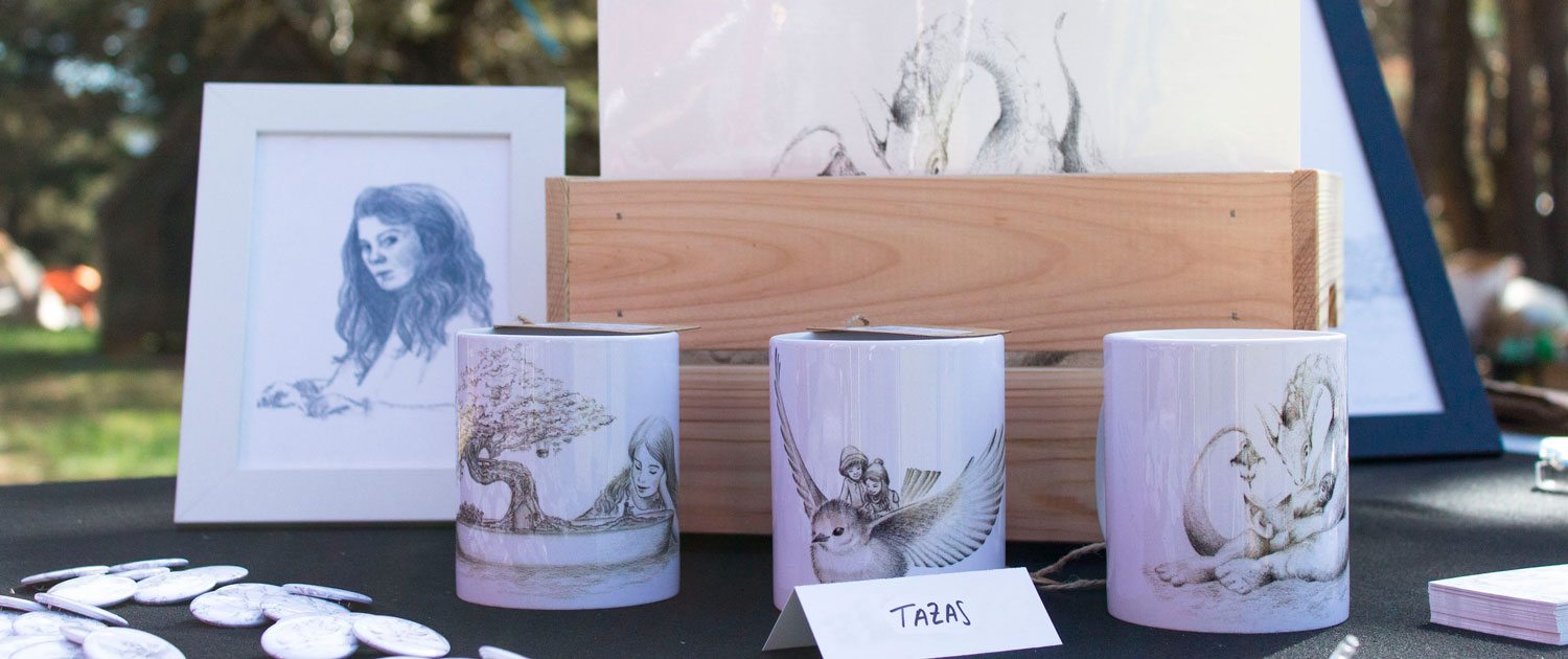 My illustrateds products at Avalon Summer Faerie Fest - Mugs